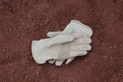 Work gloves in the crusher fines Stock Photography