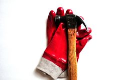 Work Gloves and a Hammer. Pair of red rubber work gloves and a claw hammer Stock Images