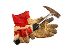 Work gloves and a hammer Stock Images