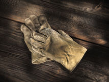 Work Gloves. Worn work gloves on wood surface Stock Images