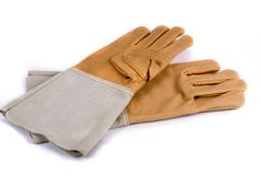 Work gloves on white background. Leather work gloves with five fingers. Shot with an exposure that brings out the leather's texture good detail Royalty Free Stock Image