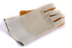 Work gloves on white background. Leather work gloves with five fingers. Shot with an exposure that brings out the leather's texture good detail Royalty Free Stock Photos