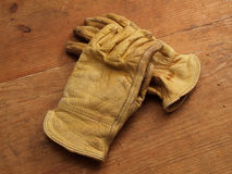 Work gloves on wood 1 Stock Photo