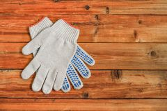 Work gloves on wooden background. Copy space. royalty free stock photos