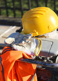 Work gloves with yellow helmet Stock Image