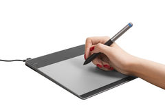 Work with the graphic tablet behind desktop Stock Photo