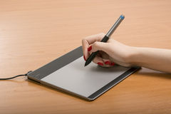 Work with the graphic tablet behind desktop Stock Images