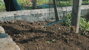 Work on the ground with a rake stock footage