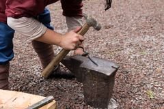 Work hammer on the anvil. In the park in nature Stock Images