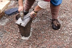 Work hammer on the anvil. In the park in nature Royalty Free Stock Photos