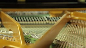 Work  hammers inside the grand piano stock video footage