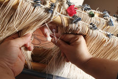 Work at handloom. A person weaving whit a handloom royalty free stock photos