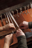 Work on an handloom. Two woman work on a old hand loom royalty free stock photos