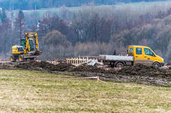 Work happening at a construction site. A shot of work happening at a construction site with machinery and raw materials seen around Stock Photo