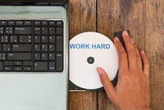 Work hard  concept laptop with compact disk Royalty Free Stock Images