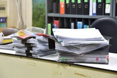 Work hard, Lot of work, Stacks of document paper and files folder. Work hard, Lot of work, Stacks of document paper and files folder on office desk royalty free stock photo