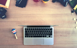 Work hard, play hard. Top view of working space of laptop surrou Royalty Free Stock Image