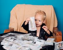 Work hard play hard. Little boy count money in cash. Small child do business accounting in startup company. Startup. Business costs. Little entrepreneur work in royalty free stock photography