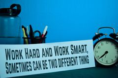 Work Hard and Work Smart, Sometimes can be two different thing Planning on Background of Working Table. With Office Supplies. Business Concept Planning on Blue stock photos