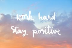 Work hard Stay positive Hand drawn lettering. Inspirational quote on beautiful sky after the sunset stock images