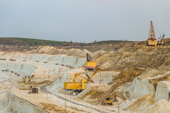 Work of heavy grab and bucket excavators in the chalk quarry Royalty Free Stock Images