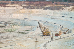 Work of heavy grab excavators in the chalk quarry. Heavy mining industry Royalty Free Stock Photos