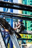 Work at height. Cutting steel structure. Work at height. Man working on the demolition royalty free stock photos