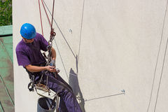Work at height. Specially equipped worker performs height work,photography stock photography