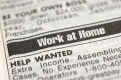 Work at home. With the current economic situation, there are many layoffs. Closeup shot of work at home newspaper ad stock image
