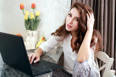 Work at home. Business person with laptop stock image