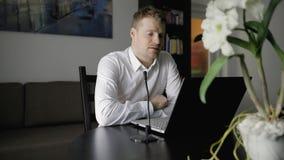 Work from home - man having online meeting in webinar. video call
