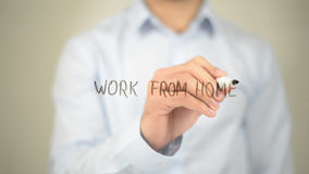 Work from Home, Man Writing on Transparent Screen. High quality stock photo