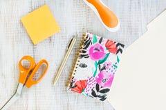 Work Office Desk With Notebook Pen Scissors Stapler Folder. Work from home office desk on white background with scissors, post it notes, stapler, pen, notebook royalty free stock photos
