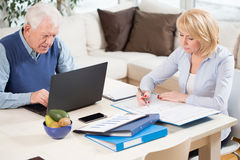 Work at home. Photo of two elderly people having work at home stock image