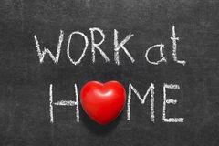 Work at home. Phrase handwritten on blackboard with heart symbol instead of O stock photos
