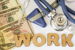 Work in hospitals, clinics, occupational medicine and pharmacy concept photo. Stethoscope, neurological hammer, dollar bills and s. Yringe is near 3D letters job Royalty Free Stock Image