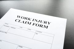 Work injury. Claim form showing business insurance concept Stock Photo