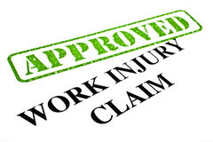 Work Injury Claim APPROVED. A close-up of an APPROVED Work Injury Claim document stock images