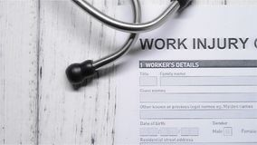 Work injury claim form with a stethoscope