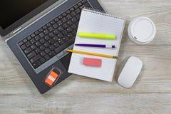 Work items on wooden desktop Stock Photos