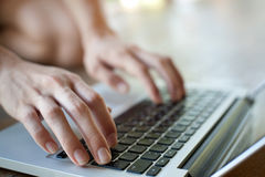 Work with laptop. Female hands Royalty Free Stock Photos