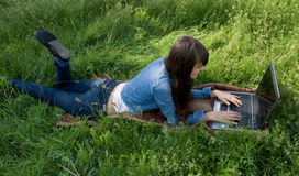 Work on laptop. Young girl working on laptop Stock Photography