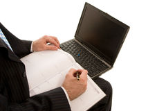 Work on the laptop. With pen Royalty Free Stock Image