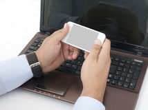 Work on Laptop and Smart Phone Stock Images