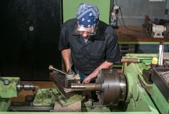 At work on a lathe. Stock Photos
