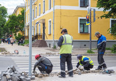 Work on laying the new tile on a city street. Lays the new tile on the floor. Paving in the city. Urban landscaping. Russia. Gatch. Work on laying the new tile Royalty Free Stock Image