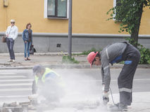 Work on laying the new tile on a city street. Lays the new tile on the floor. Paving in the city. Urban landscaping. Russia. Gatch. Work on laying the new tile Stock Image