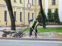 Work on laying the new tile on a city street. Lays the new tile on the floor. Paving in the city. Urban landscaping. Russia. Gatch. Work on laying the new tile Royalty Free Stock Photos