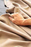 Work leather. A person work leather to make a sofa stock images