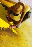 Work with leather and yellow dye Stock Photo